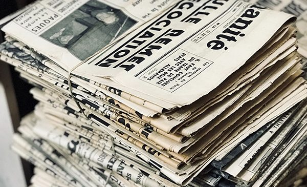 Stacked foreign language newspapers